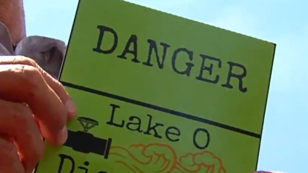Homemade signs along St. Lucie River warn of swimming in water