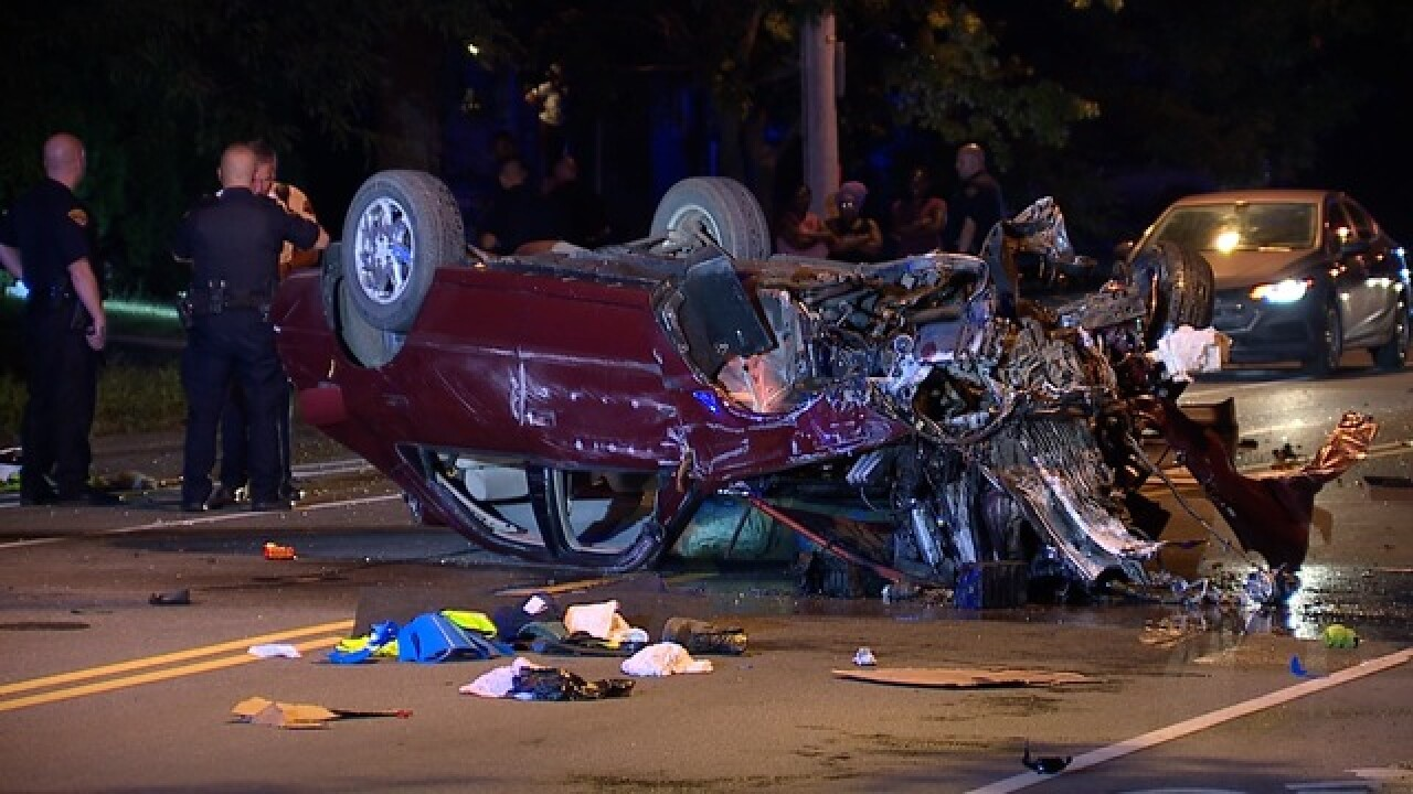 Car left mangled after hitting pole, flipping