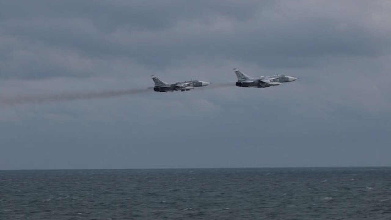 Russian fighter jets 'buzz' US warship in Black Sea, photos show