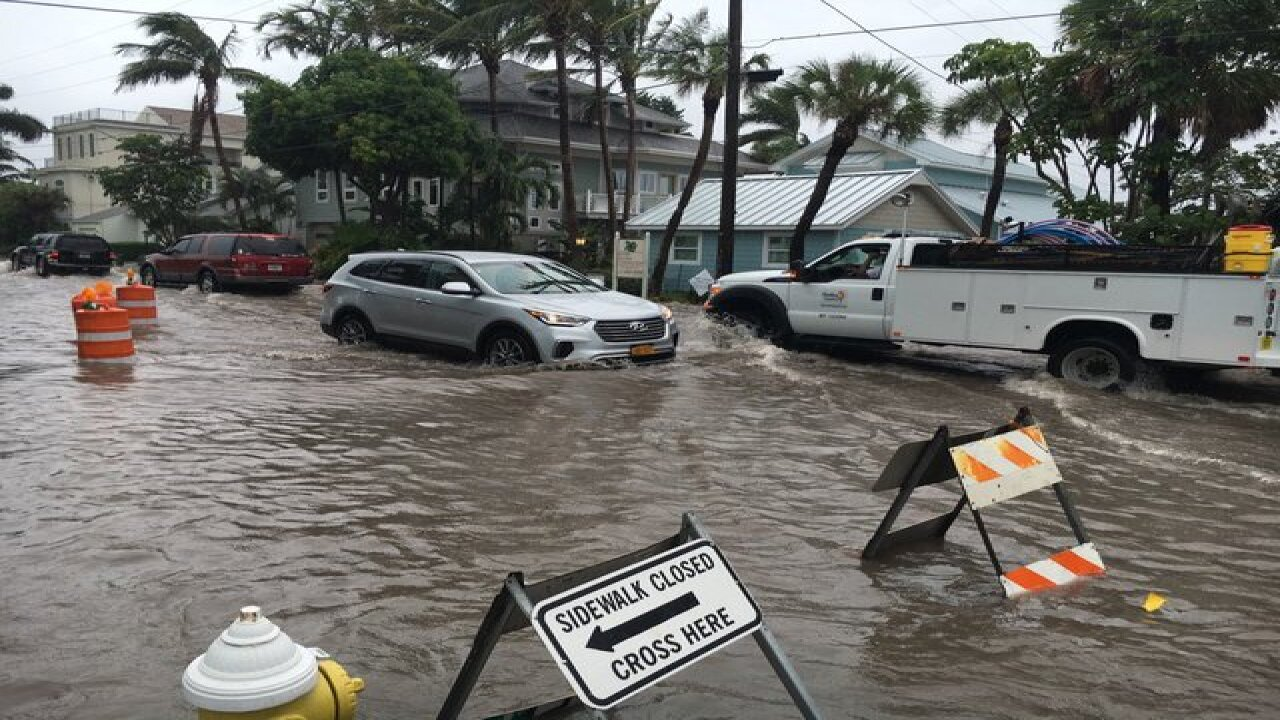 PHOTOS | Tropical system causing flooding
