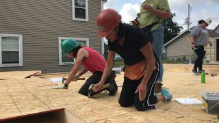 Women work together to build houses in Milwaukee