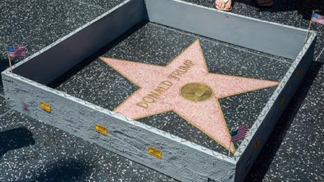 Miniature wall appears around Trump's Hollywood star