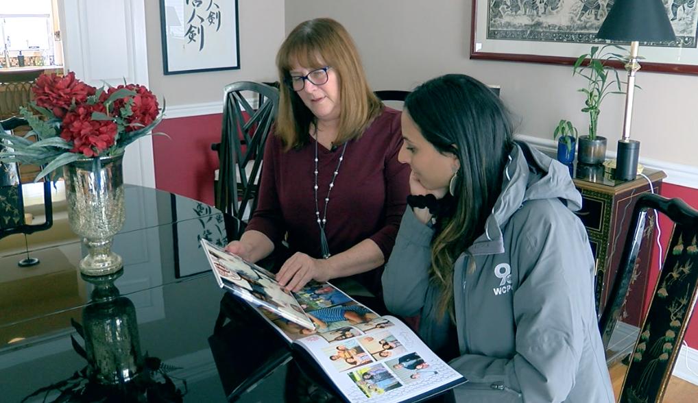Jane Hawkins showing WCPO 9 News Reporter Paola Suro photos of Lonnie Hawkins