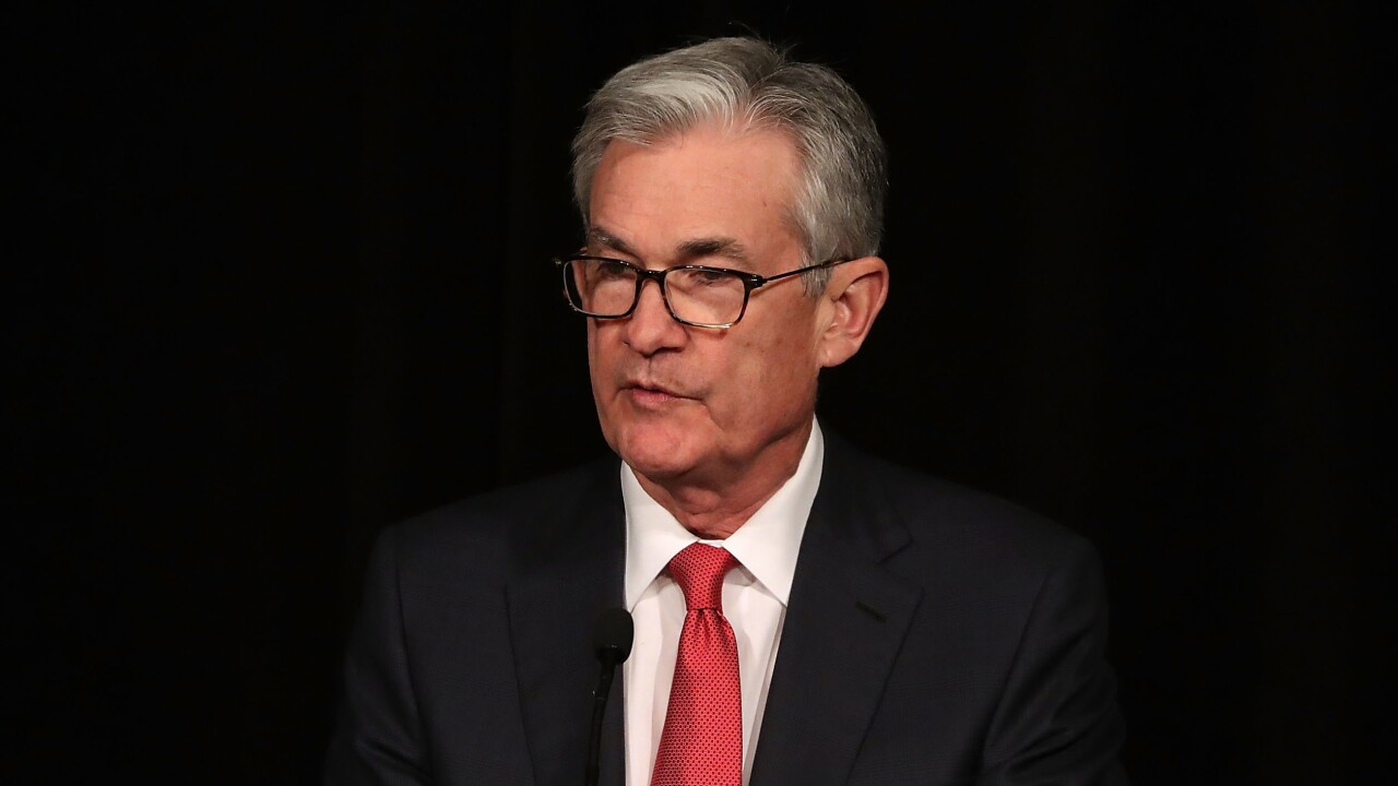 Fed keeps interest rates steady, shaves growth forecast