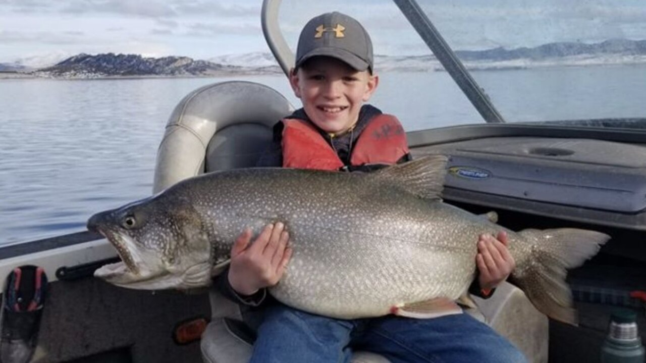 Tyler Grimshaw, 10, and the 41-pound lake trout he caught at Flaming Gorge Reservoir