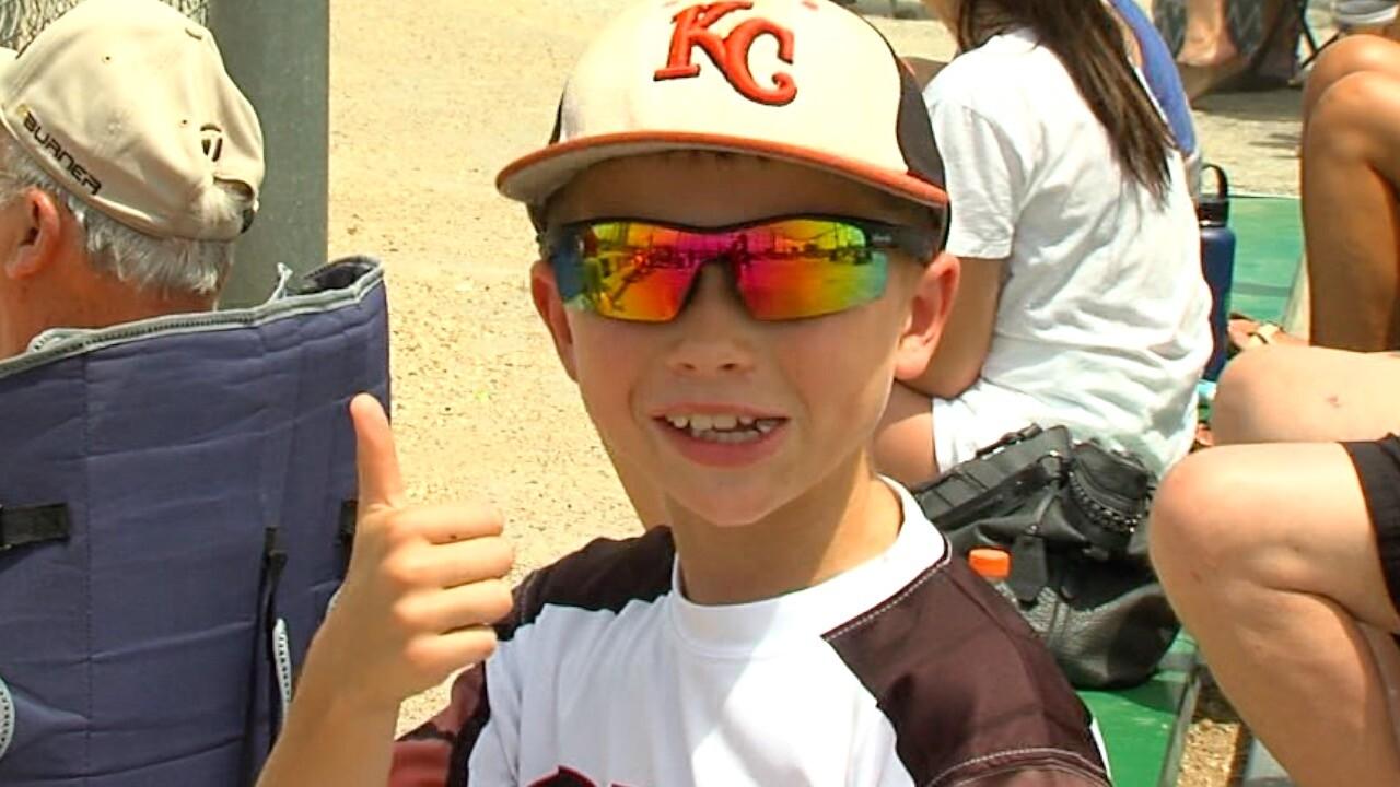 kid baseball player thumbs up