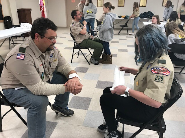 Scout Master and scout go through badge training in Mukwonago
