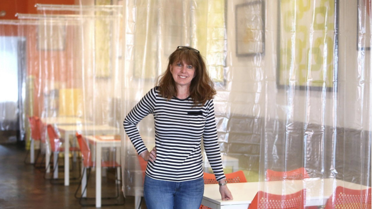 Ohio restaurant socially distancing with shower curtain partitions