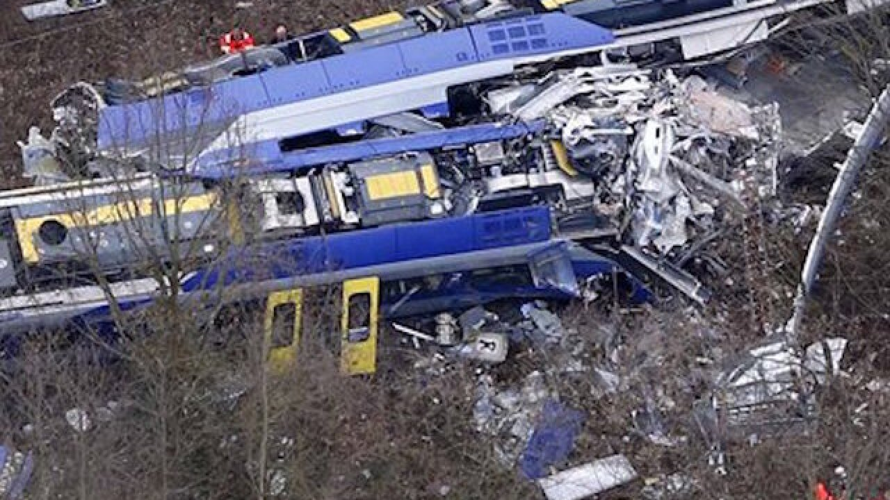 German train dispatcher used phone before crash