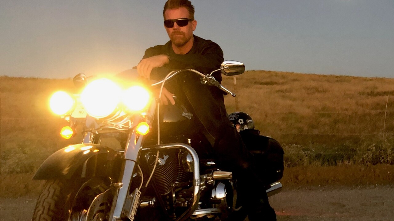 Major Scott Huesing rides motorcycle for Save the Braves