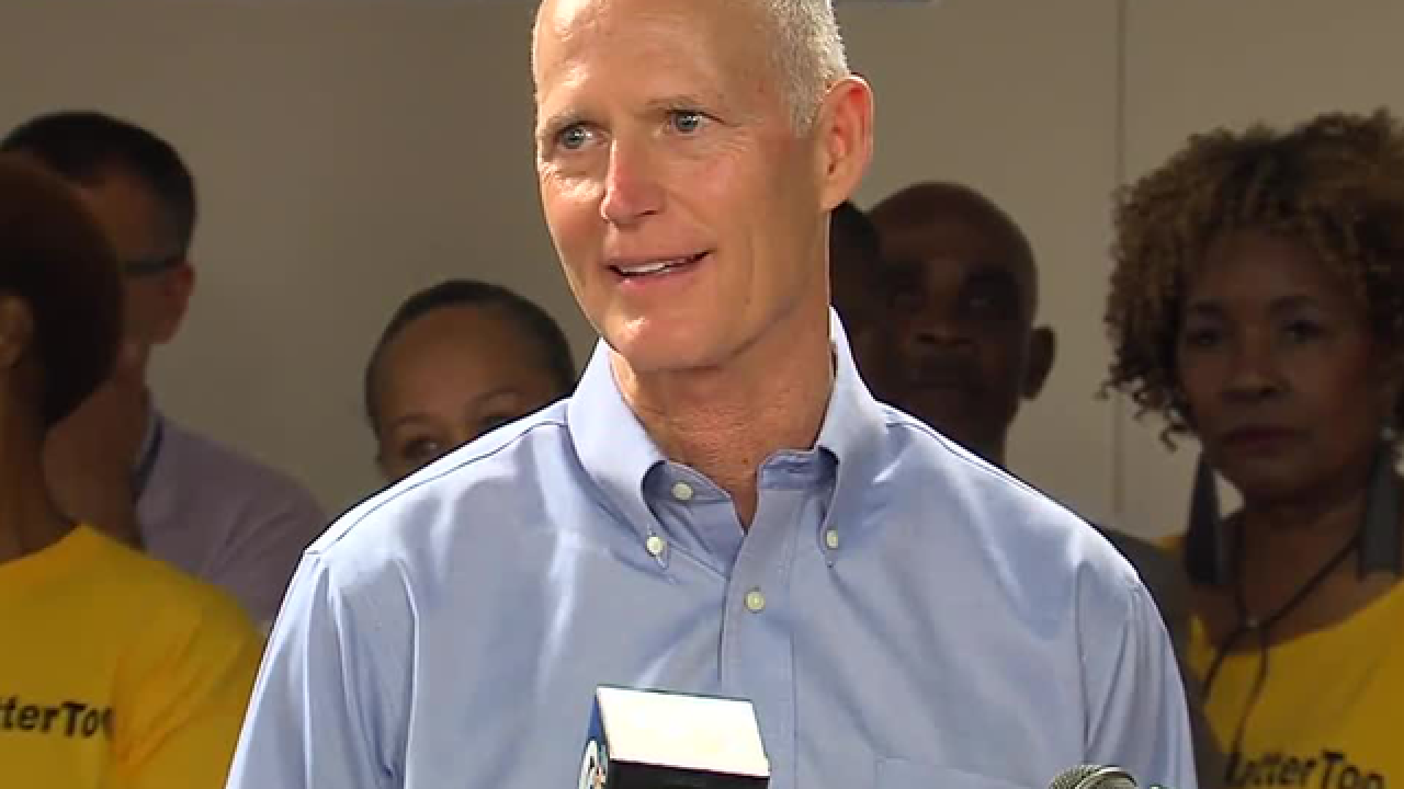 Florida Gov. Scott confronted by protesters at campaign stop in Venice, Florida