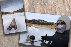 Scott Wilson taking picture of log in frozen river.jpg