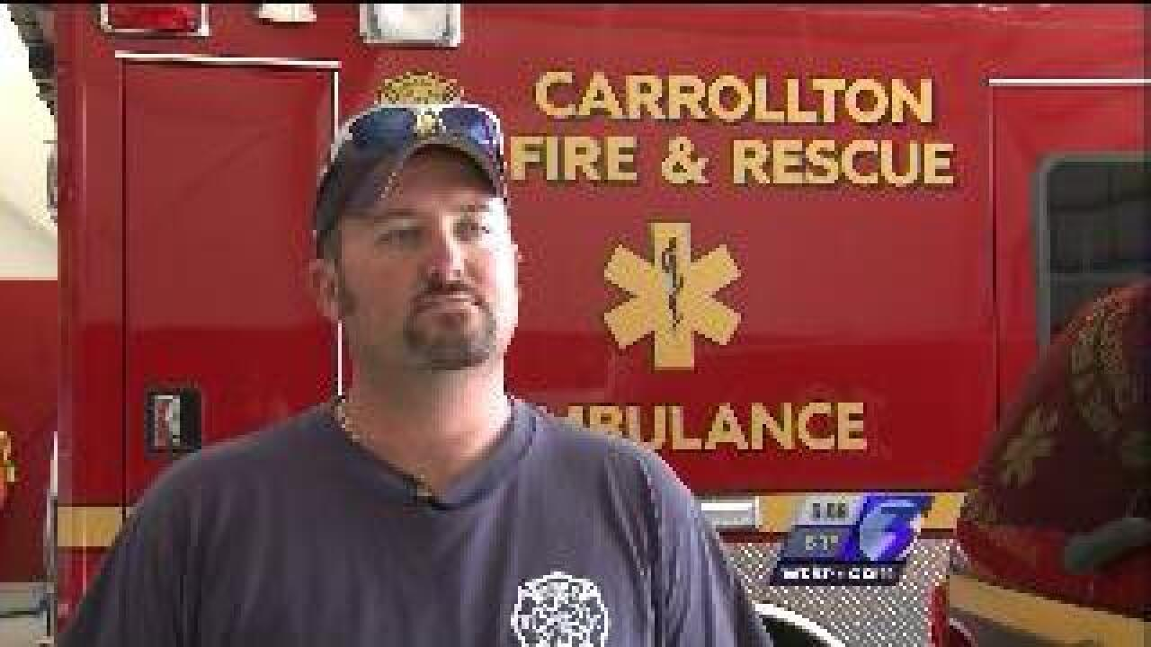 Firefighter saves three people during flood