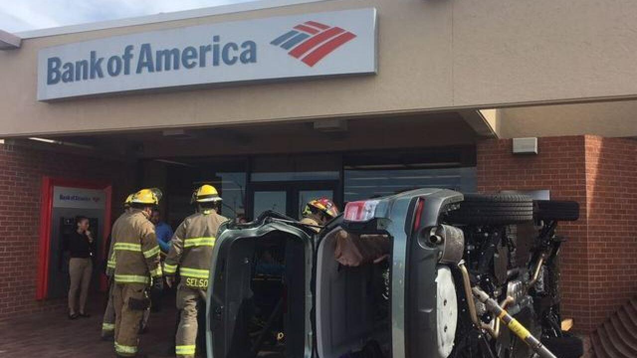 Vehicle crashes into bank on northwest side