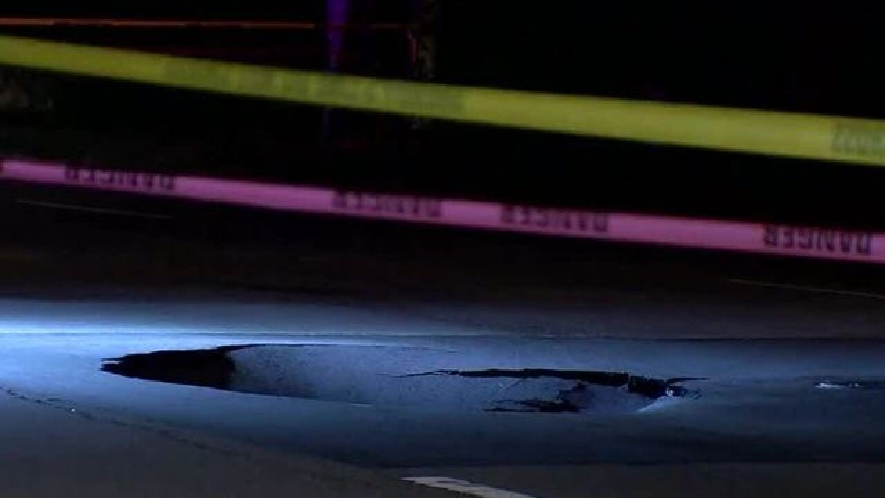 Huge hole opens up in Valrico road
