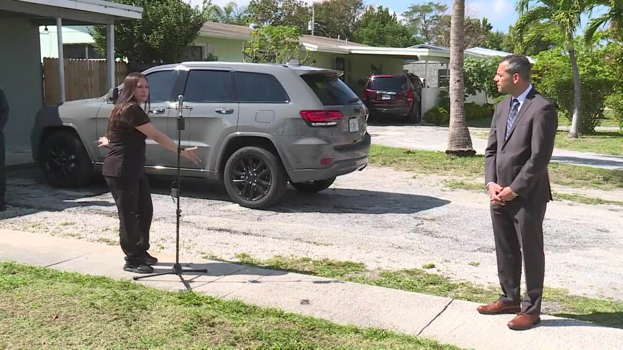 Sandy Martinez points to the driveway and sidewalk outside her Lantana home that led to more than $100,000 in parking fines