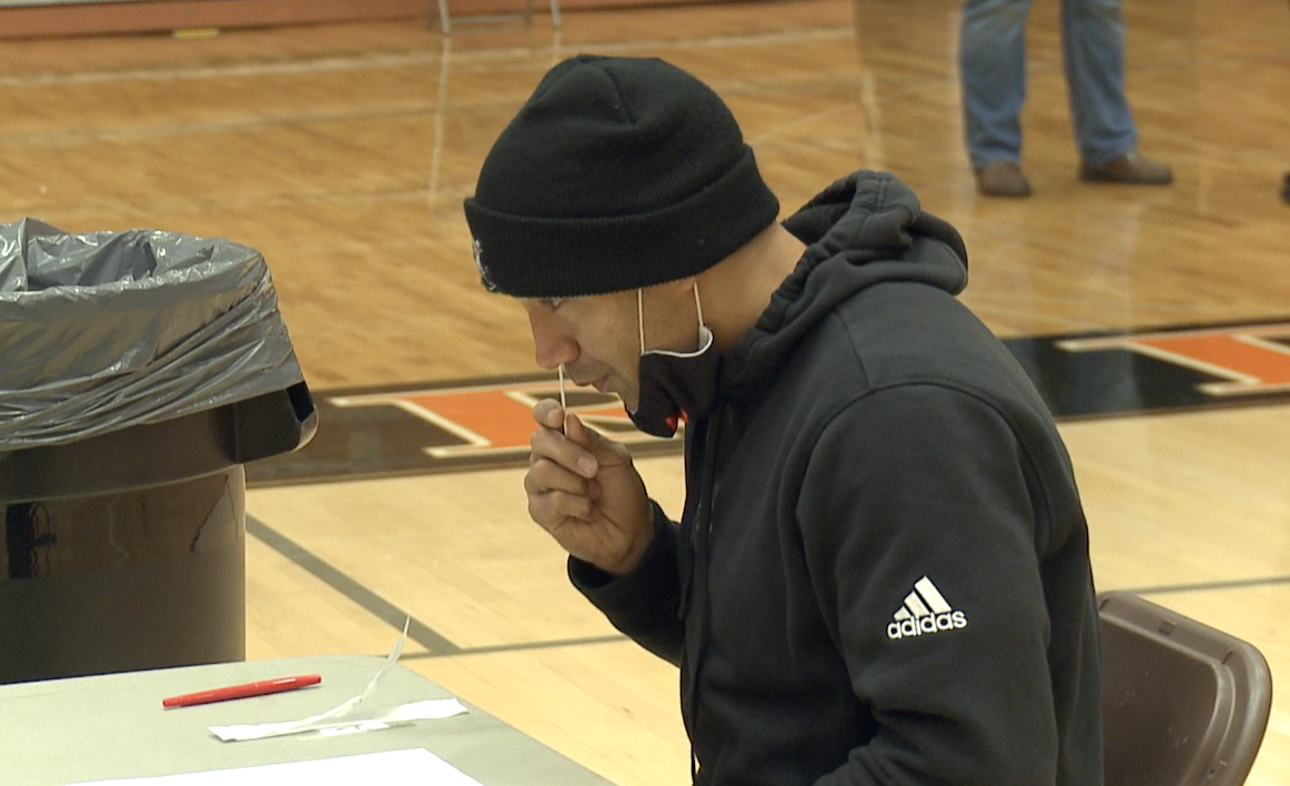 Rockford head football coach Brent Cummings gets tested for COVID-1`9