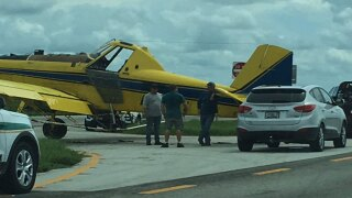 Crop duster plane on US Highway 98 in Belle Glade