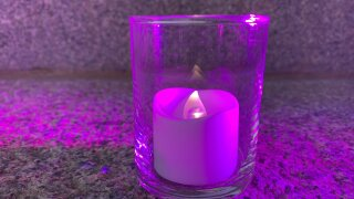 magenta candle covid one year.jpeg