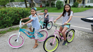 Children on donated bicycles
