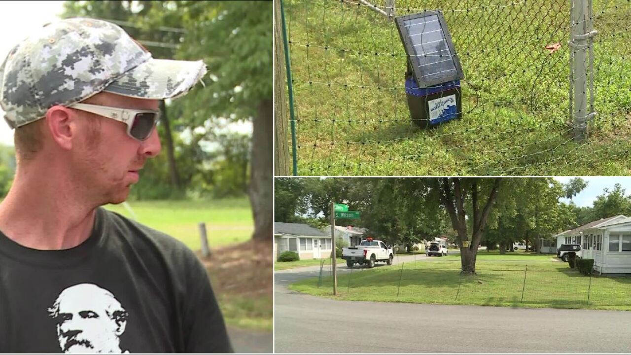 Man erects electrified fence to keep bus stop kids off hislawn
