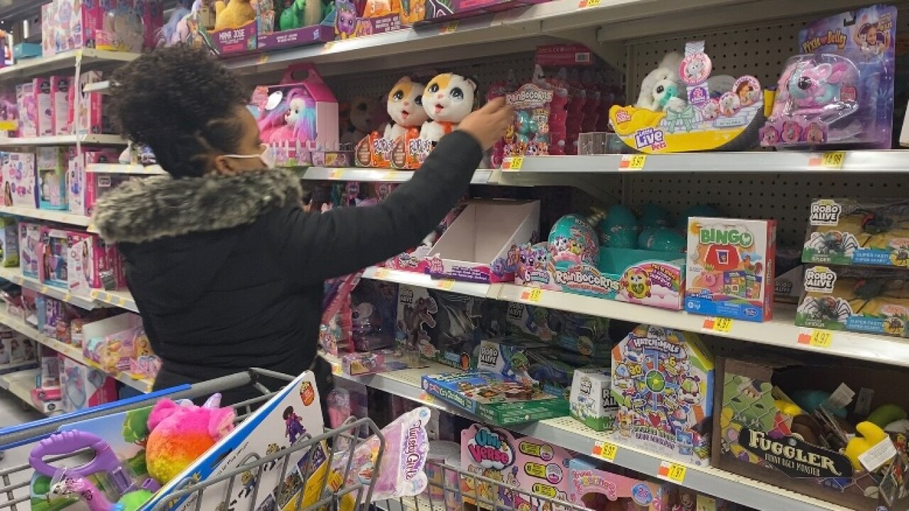 Sha'Miyae Hinton-Knight shopping for Baltimore City children through her charity, Gifted Hearts.