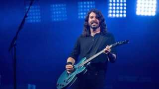 Boy rocks out on stage with the Foo Fighters