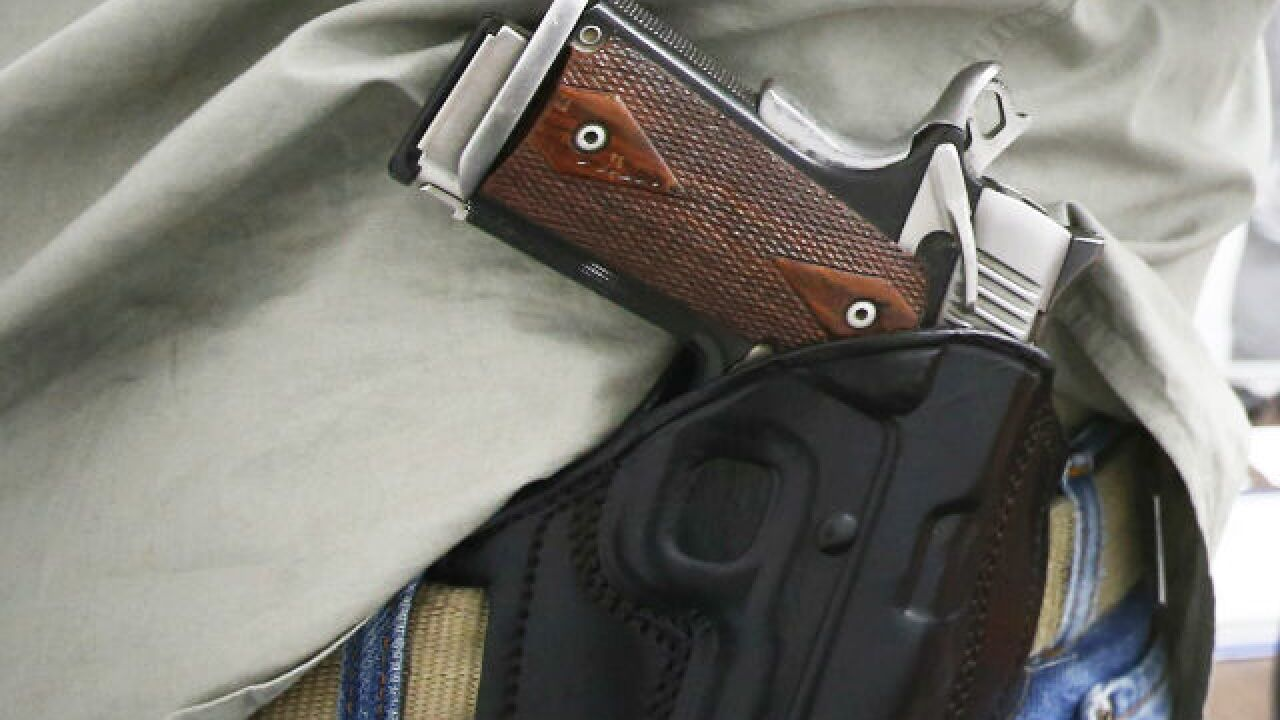 City council member packs gun but opposes relaxing concealed carry laws