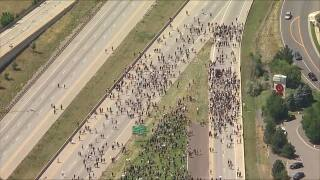 Thousands rally, march in Aurora for justice in Elijah McClain case; police use pepper spray