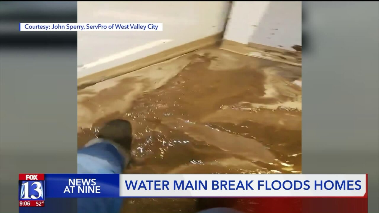Clean-up underway in Sandy after broken water line break floods streets, houses