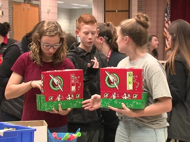 Volunteers pack Abby's Angel Boxes