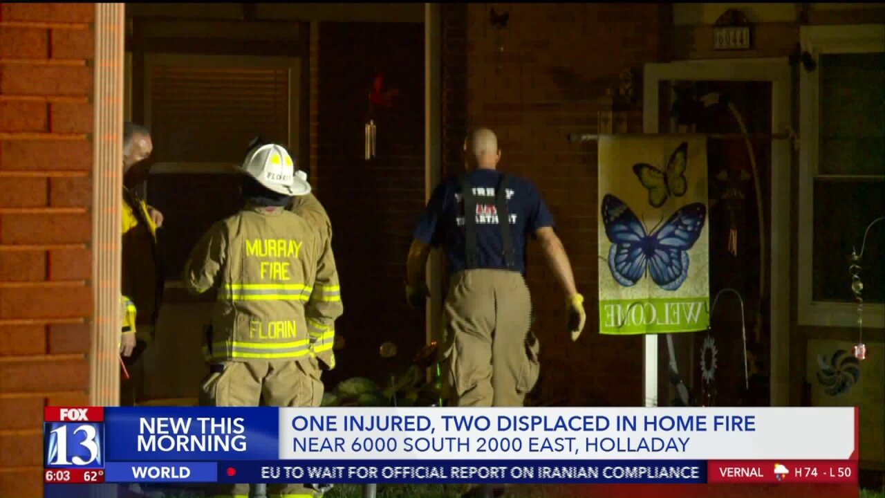 Woman taken to hospital after fire at Holladaytownhome