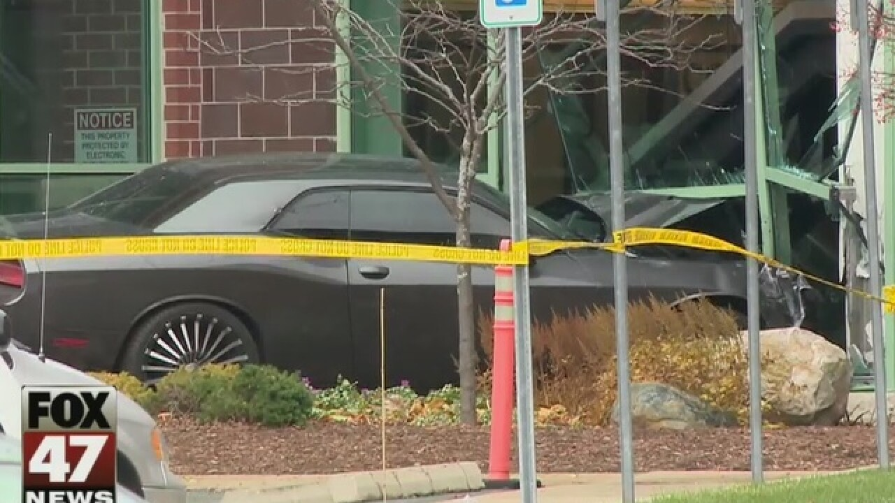 Witness: Man who drove into building disturbed