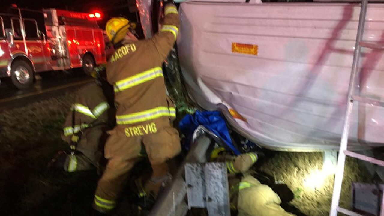 Man trapped in rolled-over van in I-97 crash