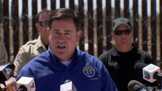 Arizona Gov. Doug Ducey Friday toured the border near Douglas, declared the border's in crisis, and blamed it on President Joe Biden.
