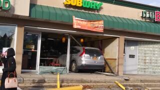 vehicle slams into subway store.jpg