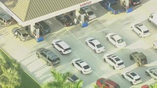 vehicles line up for gas at Costco in North Palm Beach, May 12, 2021
