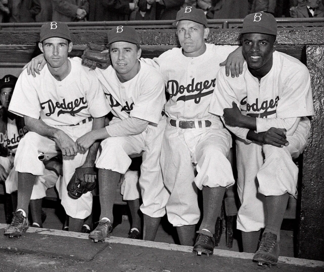 (In this April 15, 1947, file photo, from left, Brooklyn Dodgers baseball players John Jorgensen, Pee Wee Reese, Ed Stanky and Jackie Robinson pose at Ebbets Field in New York. AP Photo, File)