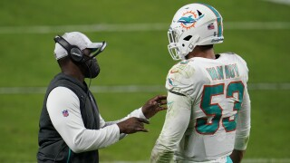 Miami Dolphins head coach Brian Flores speaks to linebacker Kyle Van Noy in December 2020