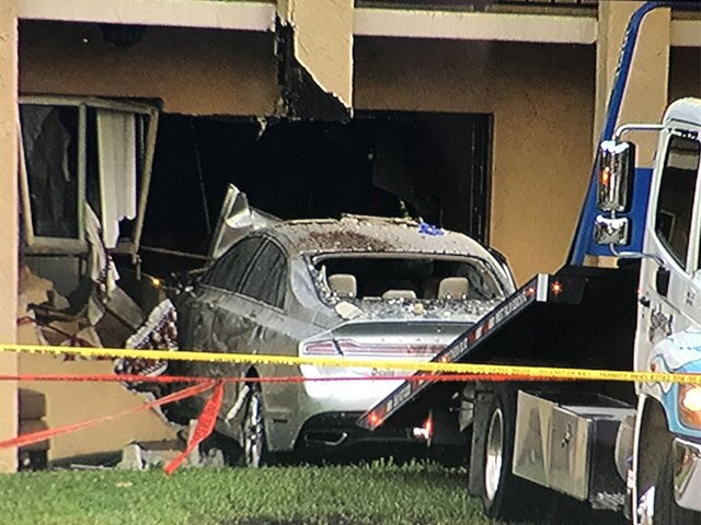 PHOTOS: 2 dead after car crashes into apartment