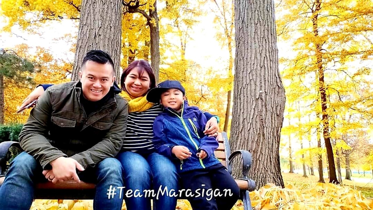 Ace-Marasigan-left-wife-and-son-outside-fall.jpg