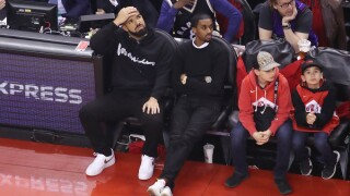 Drake relaxes during Game 6 of Eastern Conference Finals against Bucks
