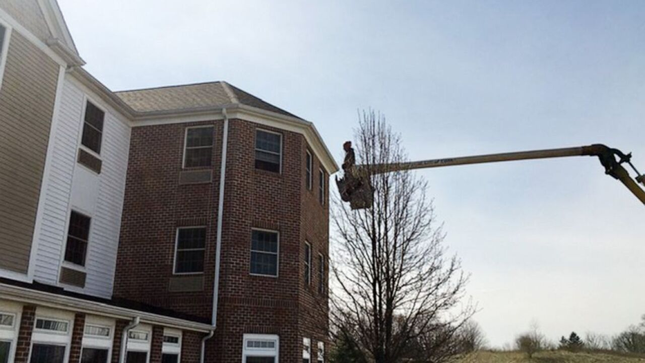 Charley Adams, 45, uses his company's bucket truck to visit his 80-year-old mother quarantined on the 3rd floor of a nursing home in New Middletown, Ohio, March 22, 2020.Charley Adams, 45, uses his company's bucket truck to visit his 80-year-old mother quarantined on the 3rd floor of a nursing home in New Middletown, Ohio, March 22, 2020.