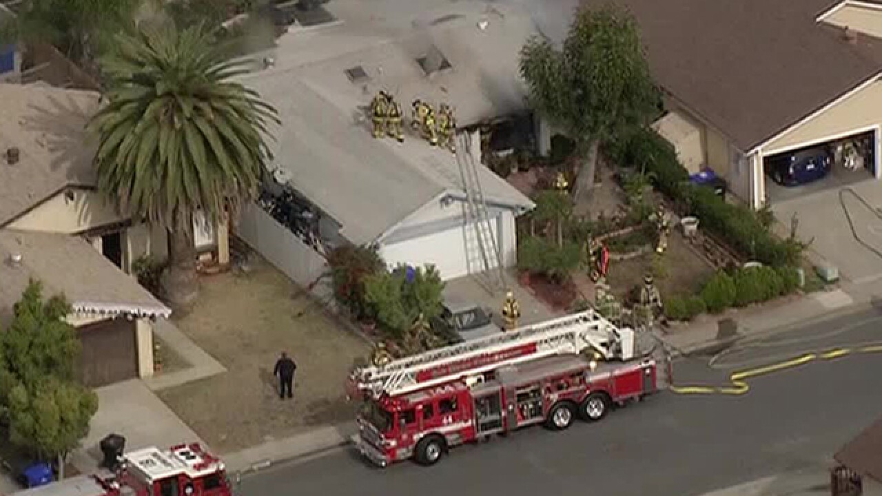 Candle sparks Mira Mesa house fire