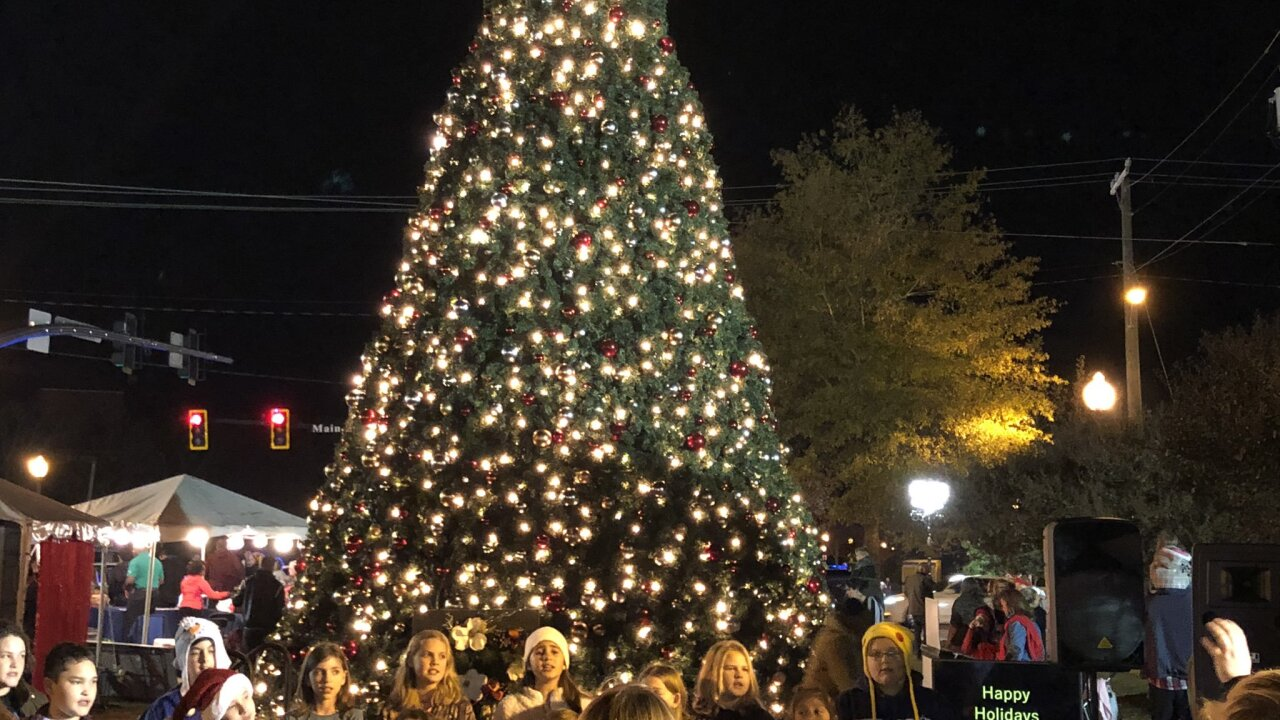Guests enjoy 'Suffolk Grand Illumination' as 32 foot tree lights up the city