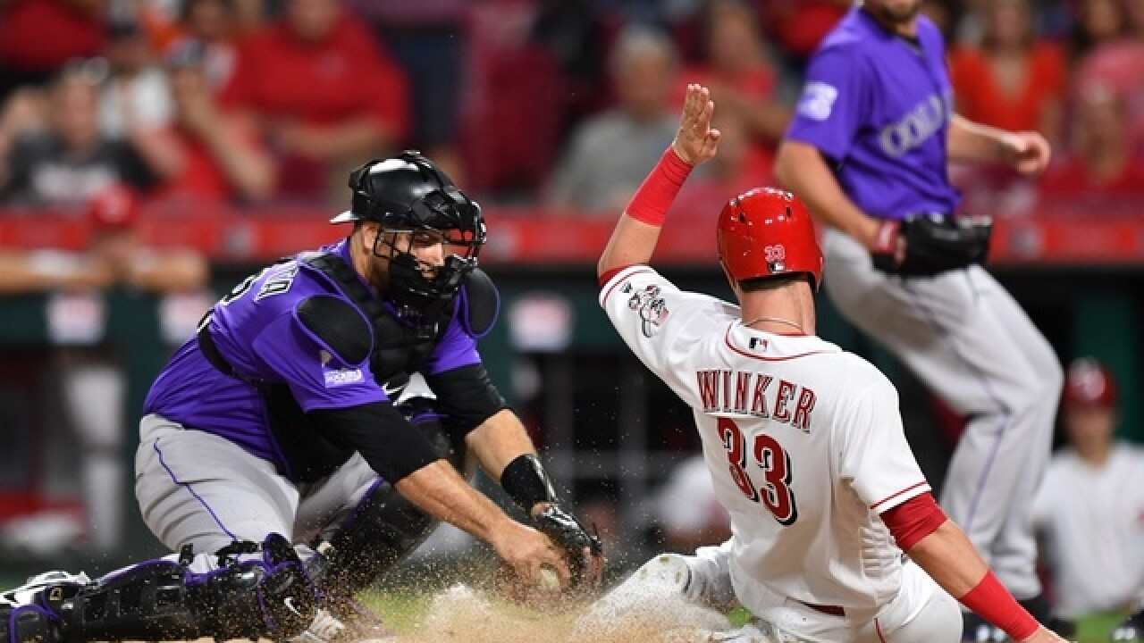 Homers by Iannetta, Gonzalez send Rockies over Reds 9-6