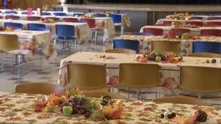 Volunteers prepare Thanksgiving meal for the homeless