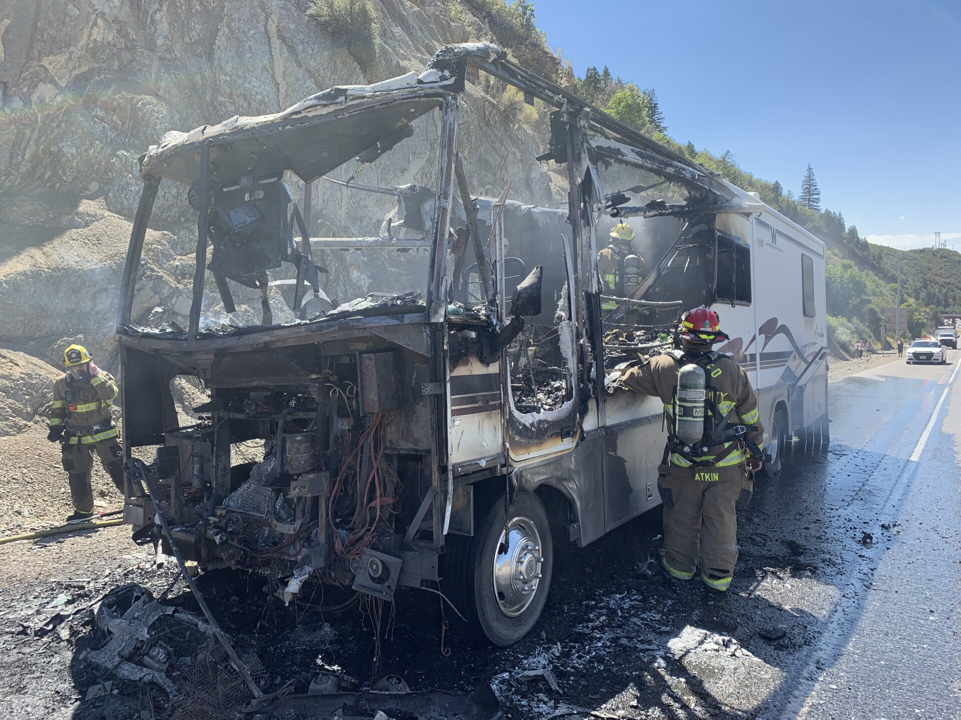 Photos: RV catches fire in Parley's Canyon; passing driver rear-ends fire truck on scene