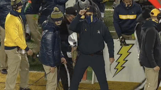 "Harbaugh wears blue pants, telling Brad Galli, ""You don't want to become like stale bread"""