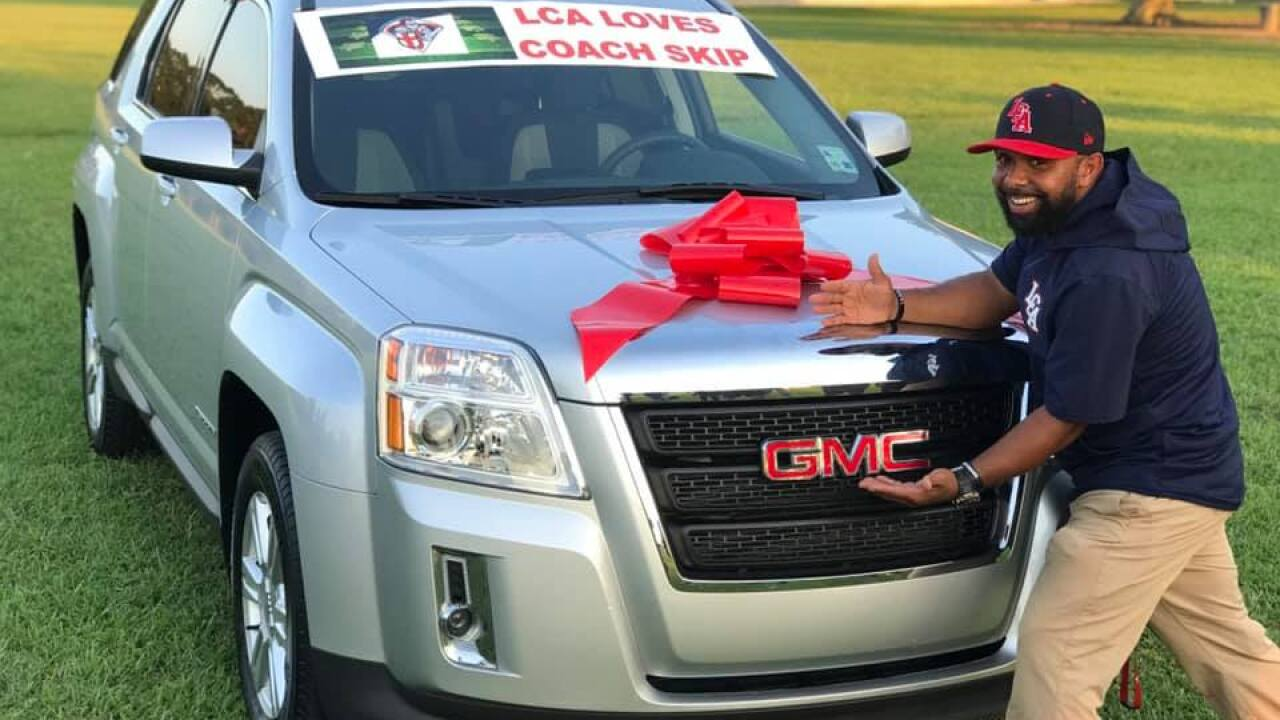 Grade school football players in Louisiana surprise their coach with a new car